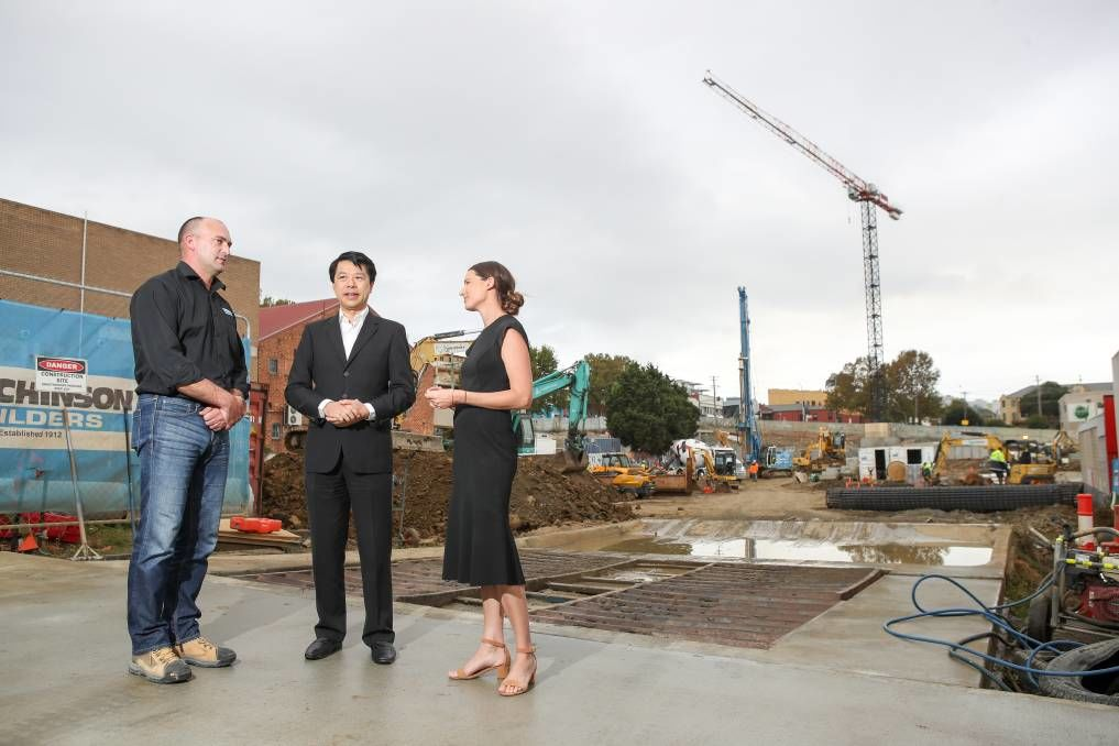 Shane Wilson, project manager for Hutchinson Builders with Alex Lei from developers BRDB and Holly Charters from Colliers / Picture: Adam McLean (Illawarra Mercury)