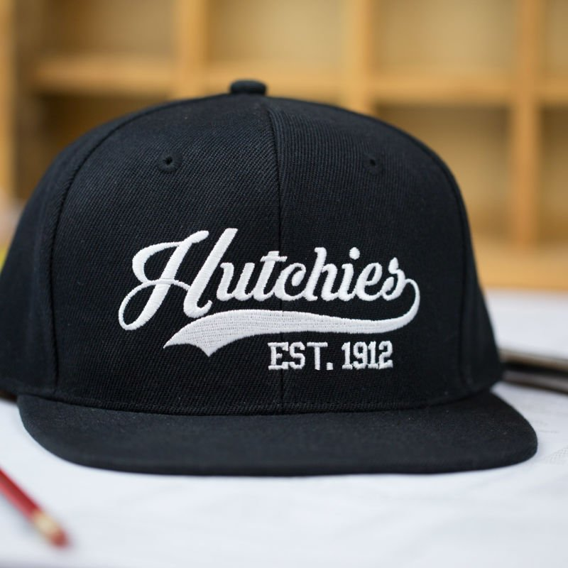 HB-Merch-Hats-Snapback-HutchiesEst1912-1-LowRes-.jpg